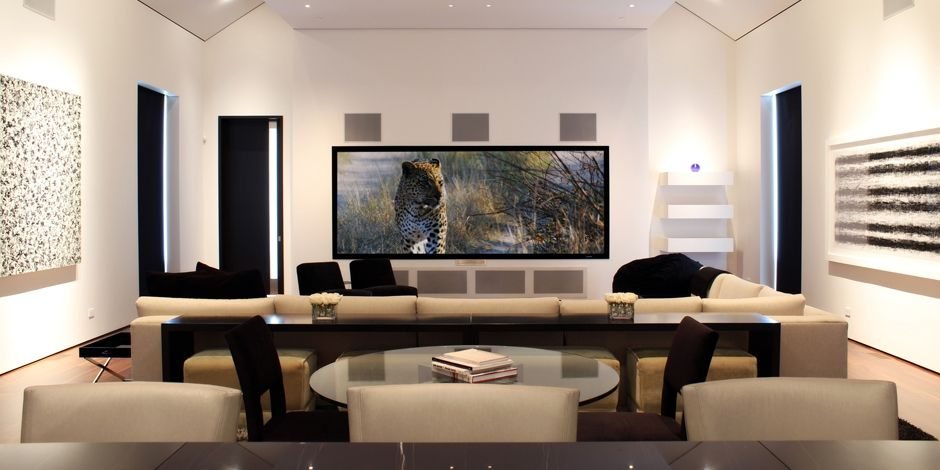 Modern media room with open  airy design offers great audio video  performance for movies  gaming  and sports. Amazing Media room  party barn  designed by Engineered