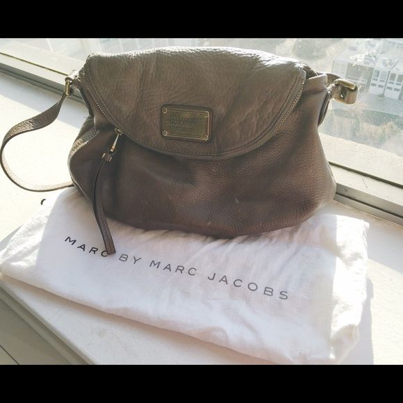 taupe Marc by Marc Jacobs cross body bag leather, very durable and beautiful color that goes with everything! 1-2 markings on leather as seen in picture. Stored in original dust bag Marc by Marc Jacobs Bags Crossbody Bags