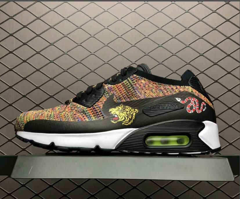 detailed pictures ebe2b 71e1d This Nike Air Max 90 Ultra Flyknit Multi-Color 2.0 features a full Flyknit  constructed upper that combines a mixture of Bright Crimson, Paramount Blue  and ...
