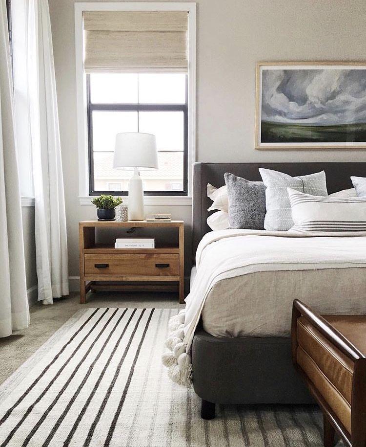 Minimal Farmhouse Master Bedroom. Striped Rug, Wood Rustic