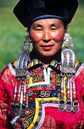 China | Portrait of a Mongolian woman wearing a festive costume.  Xilin Gol Grassland, Inner Mongolia Autonomous Region |  © TAO Images