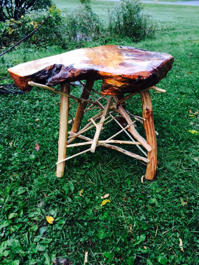 Pine top end table . With a maple stick base .