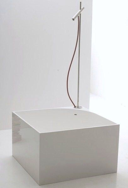 Small Footprint Bathtub with Shower Combo via NIC Design Living