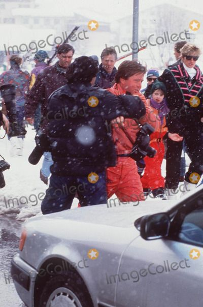 Bodyguard Ken Wharf struggles with photographer as Diana looks on.