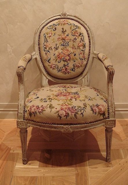 """Armchair Louis XVI period - AO76AC    Product ID: AO76AC    Armchair Louis XVI period with taped fluted legs and Marie-Antoinette bow on the top of the medallion shape back.    Original lacquer. Tapestry """"au gros point""""    From Paris - Circa 1790"""