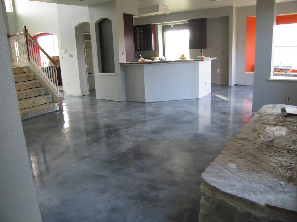 Stained cement floors vivid decorative concrete for Black stains on concrete