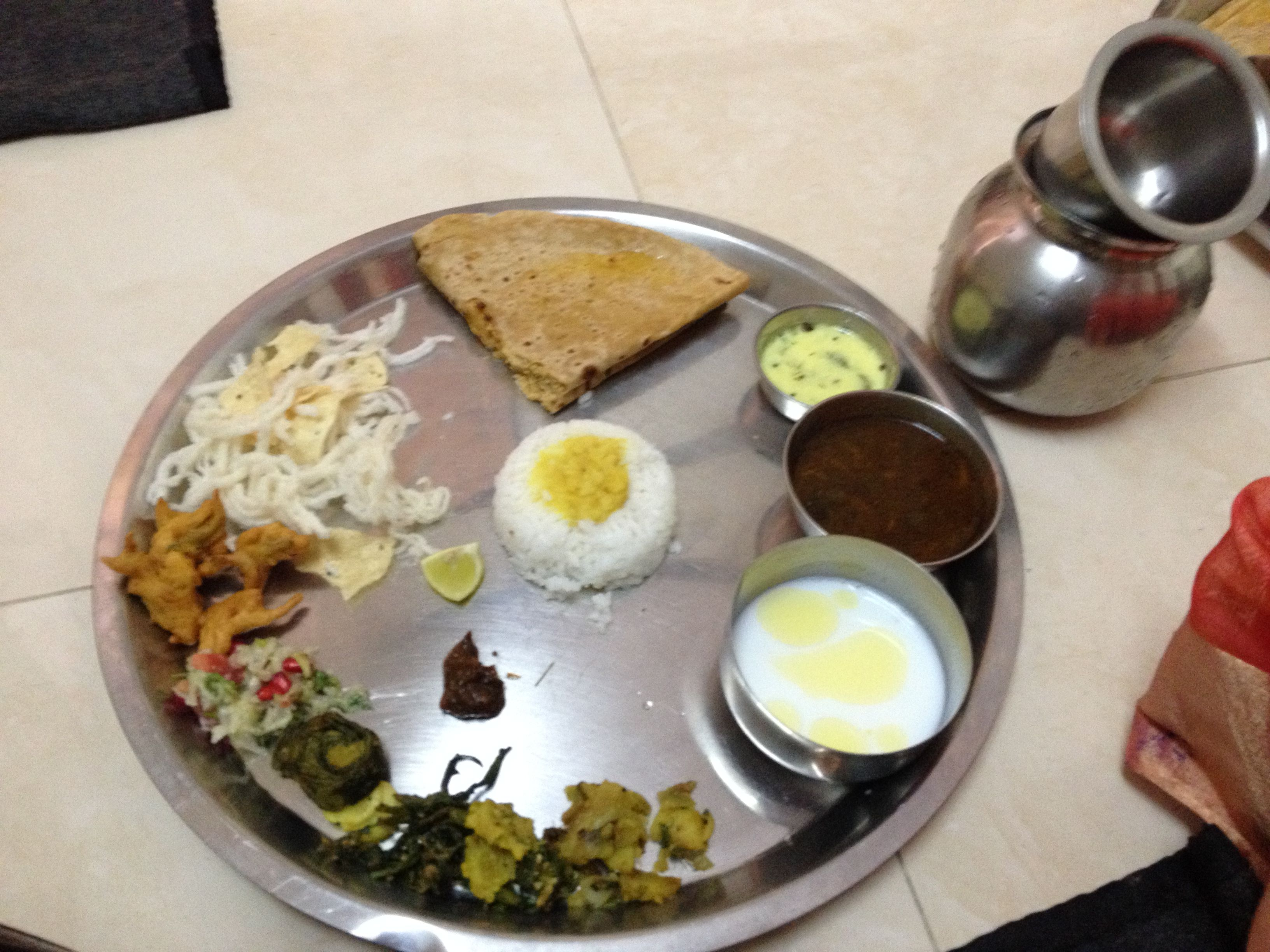 Maharashtrian thali for 'Gauri Pooja' ( Marathi thali during prayers offered to Goddess 'Gauri'- mother of Ganesha) The bread is called 'Puran-poli' ( stuffing of jiggery,bengal gram,saffron, cardamom)