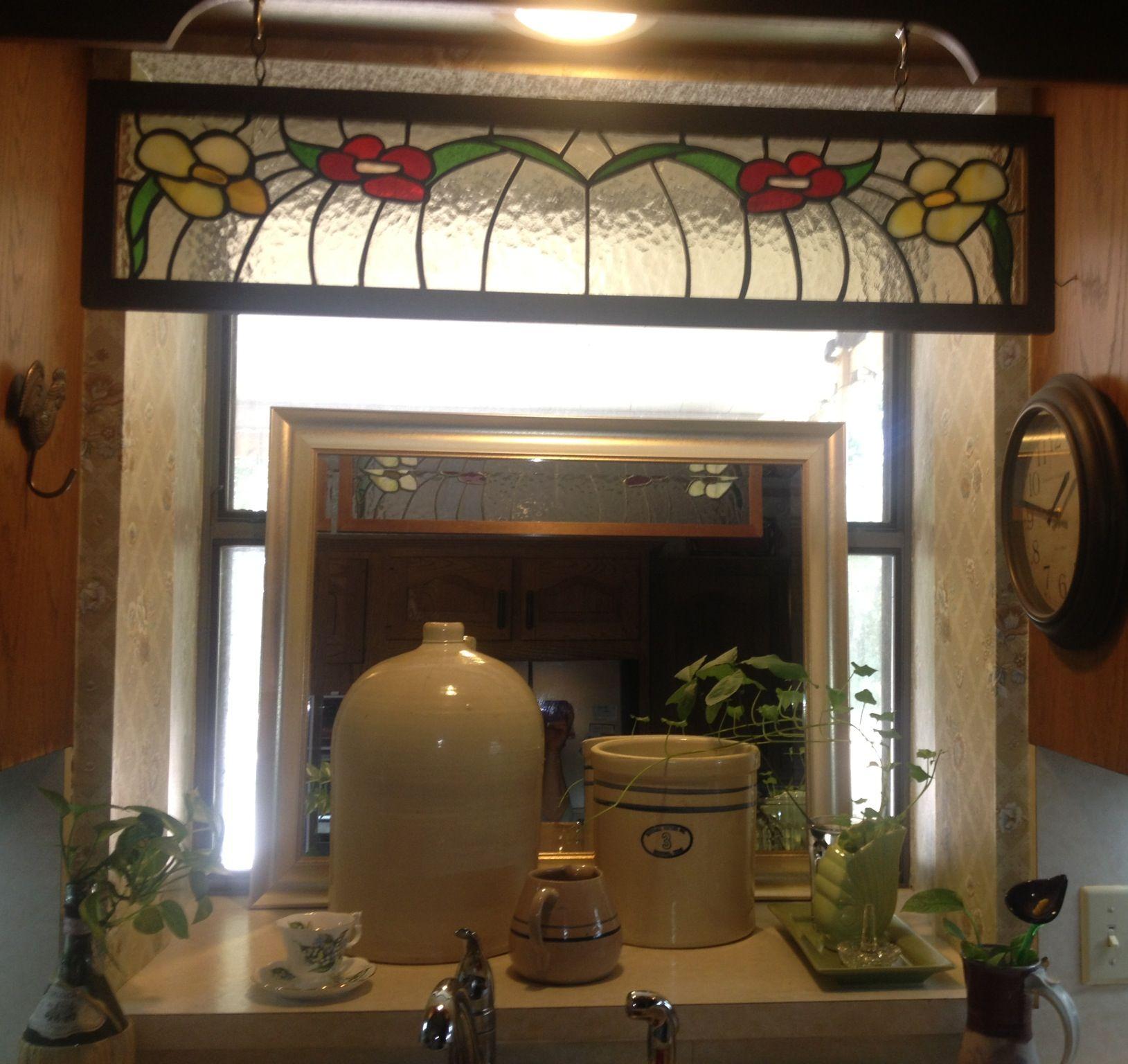 Interesting Idea... Added Mirror In Kitchen Sink Window.
