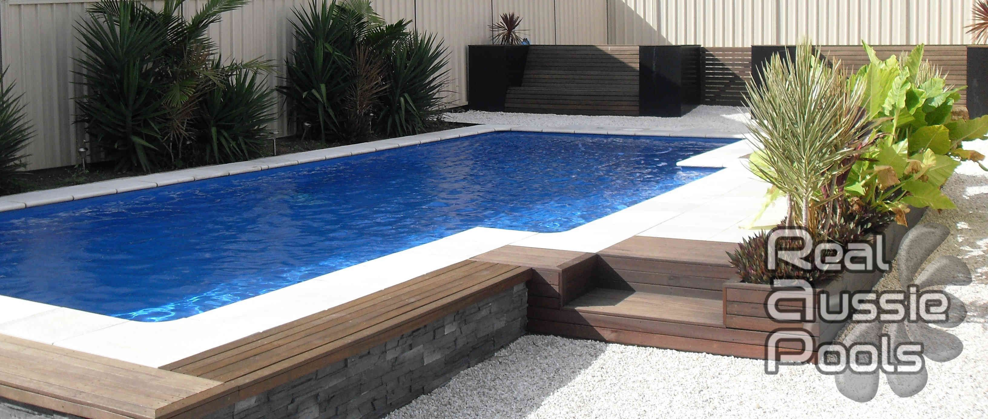 fibreglass permanent pool with stone materials pool frame and fresh plant decorating also minimalist wooden pool side for above ground plunge pool design