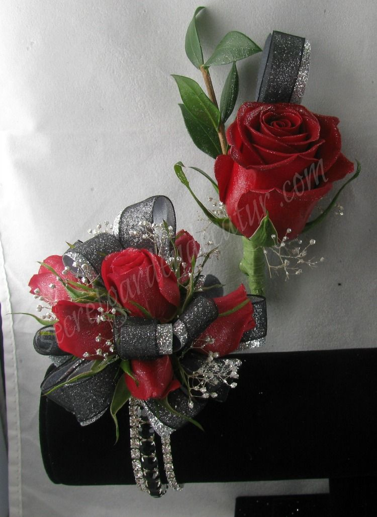 Deep Red Roses with silver and black ribbon.  The bracelet is rhinestones and in 3 parts.  2 Clear Rhinestone bands and one black.  $47.00