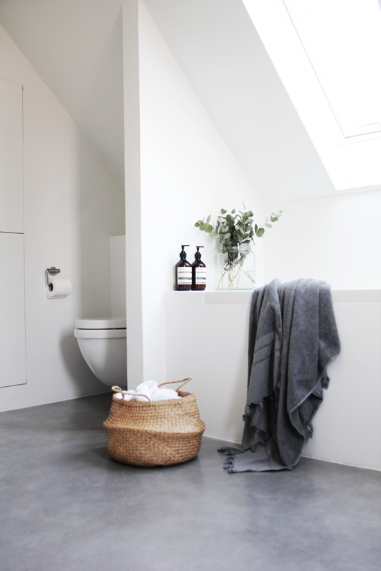 Bathroom-envy. Concrete floor + white walls + towel storage basket + built in tub under slanted sky light!! A CanDoBaby! fave.