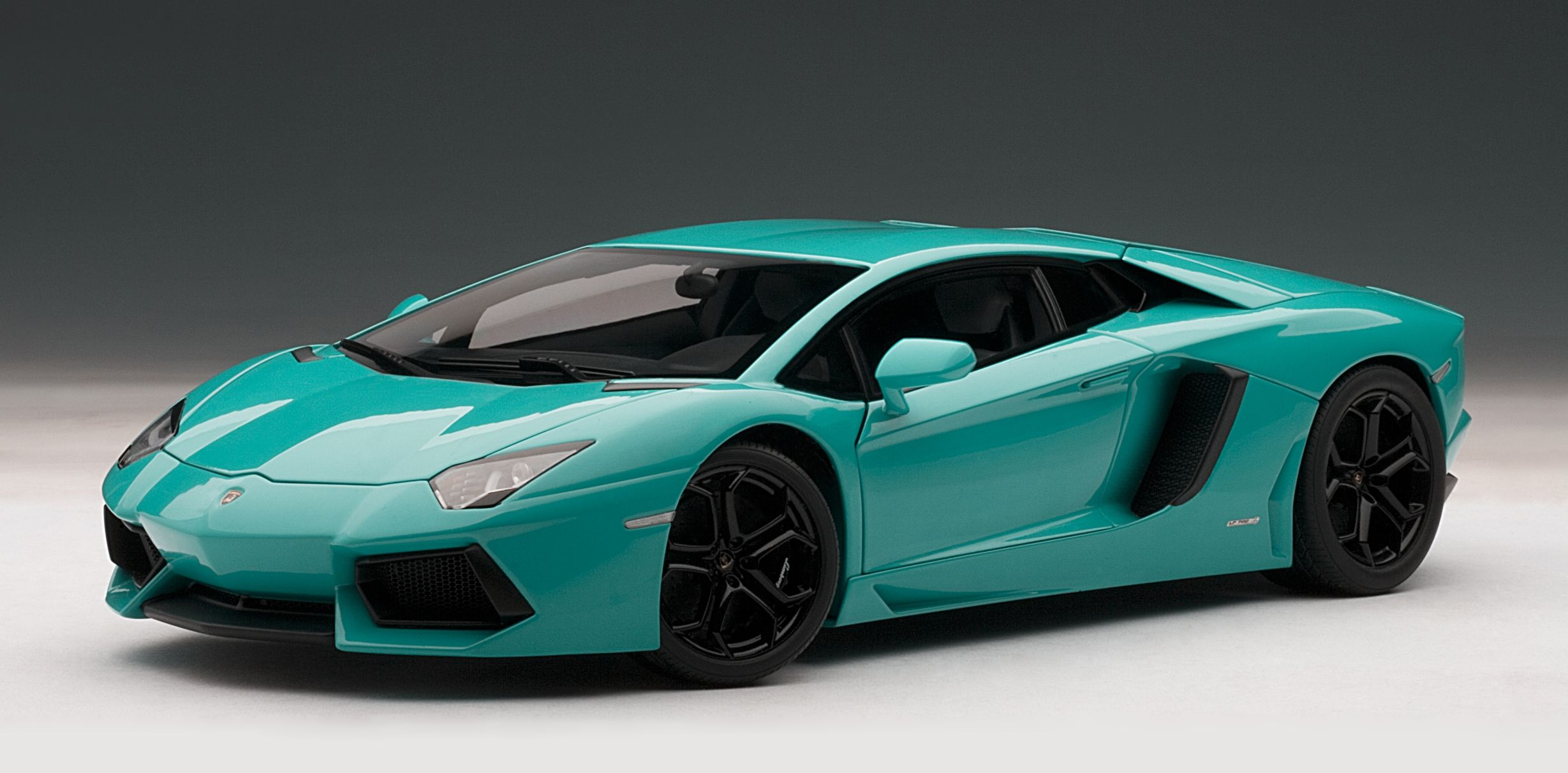 This Lamborghini Aventadorcast Model Car Is Turquoise And Features Working Steering Suspension Wheels And Also Opening Bonnet Boot With Engine