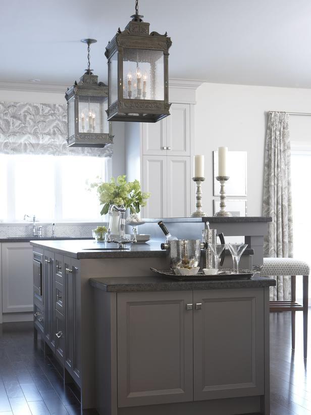 Taupe and ivory cabinets with tri-level island and oversized lanterns ~ Sarah Richardson