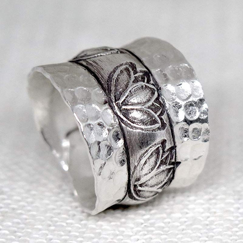 Handmade hammered sterling silver wide band
