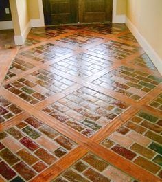 combination wood and brick inlay floors   Runningbond in the color Windsor inlaid with Pre-Finished Scraped Pine