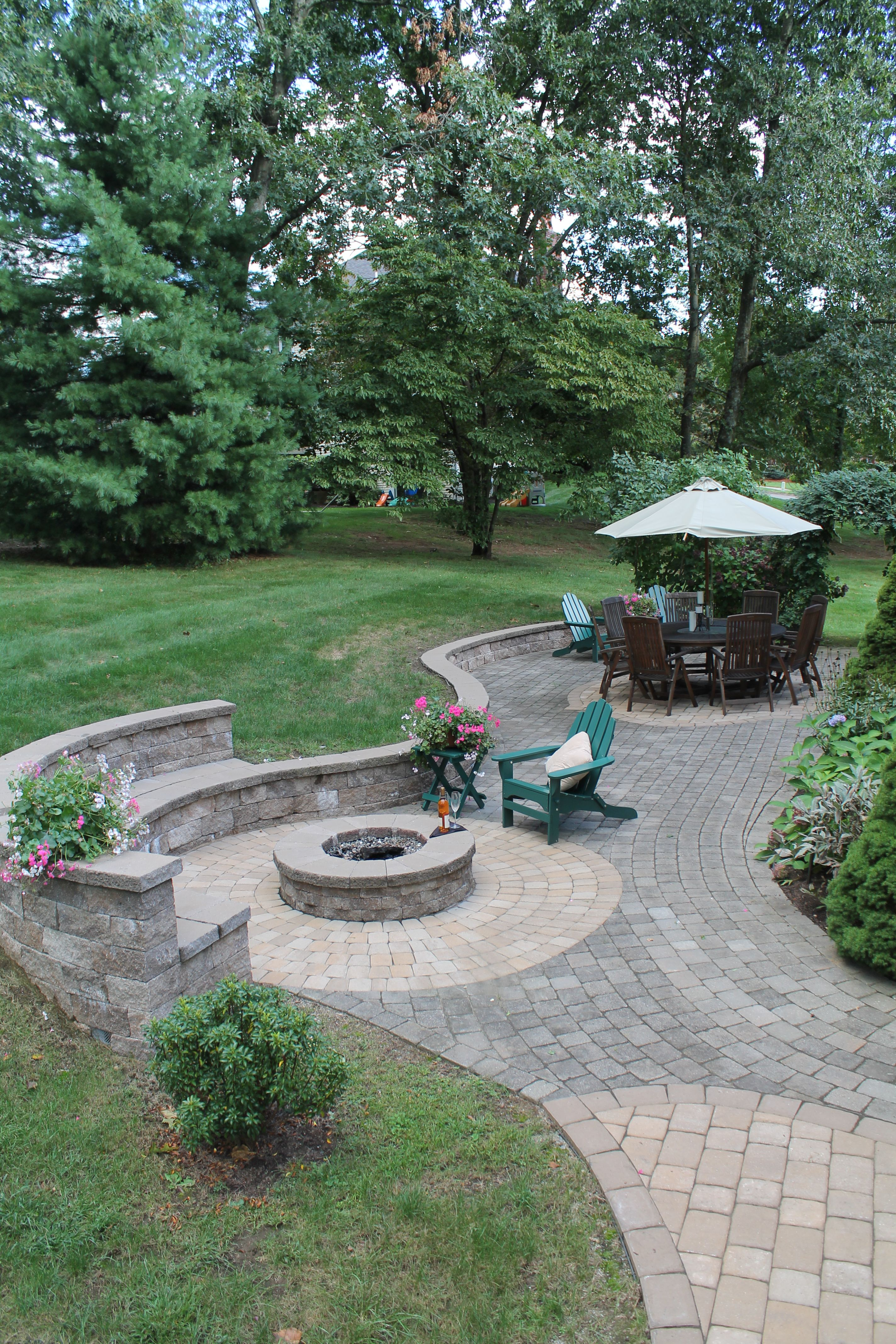 paver patio with grill surround fire pit and stone steppers that