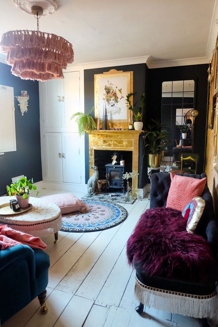 a dramatic black living room transformation with a gold