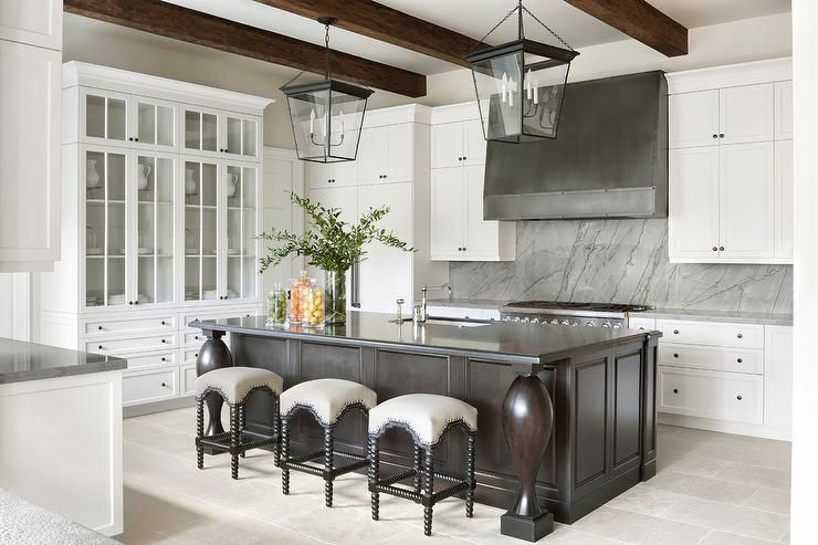 Stunning Noir Abacus Counter Stools Sit At A Leathered Black Granite Countertop Complementing An Espresso Stained Island Kitchen Design Home Kitchens Warm Wood