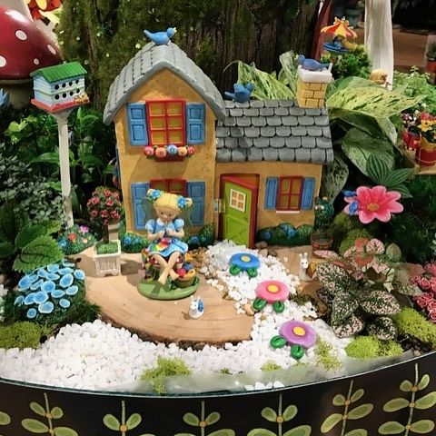 It's Charlotte, the craft fairy, at work outside her little solar-powered cottage at the Atlanta Gift Show!