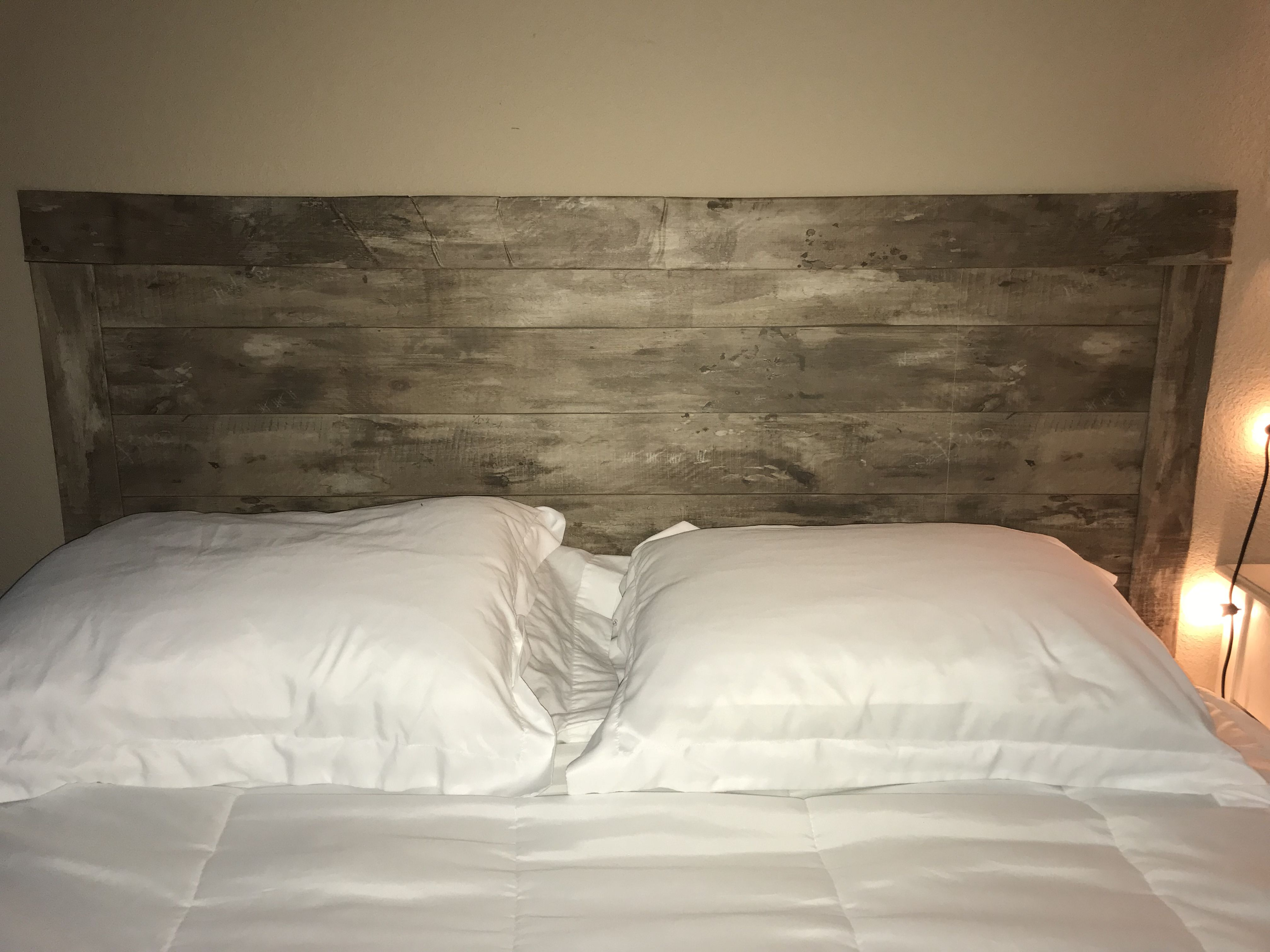 Faux Wood Headboard Made From Stick And Peel Wallpaper With