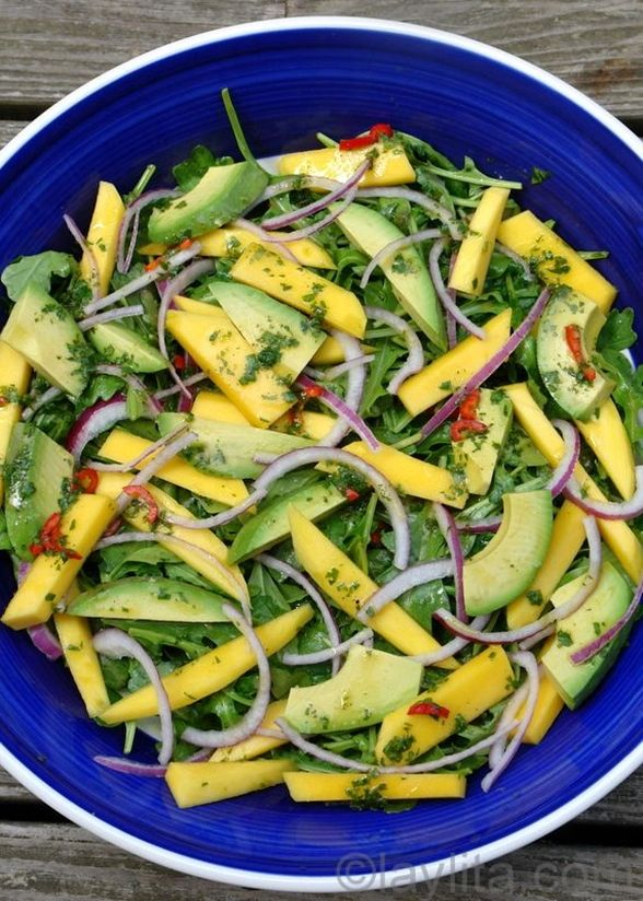 An entire bowl of mango. avocado, and arugula salad. Low carb. I'd serve it with lime, salt, and powdered chile de árbol.
