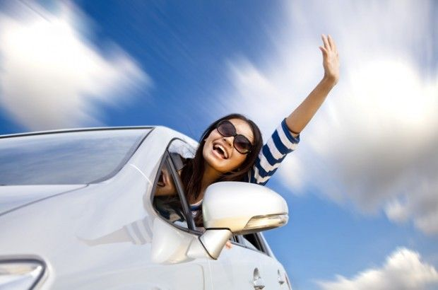 Happy Young Woman In Car Driving On The Road Auto Insurance