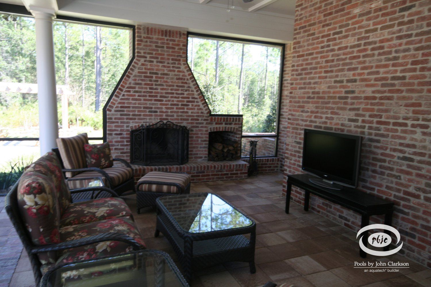 Outdoor Living Room positioned near Brick Wood burning ... on Outdoor Living Space Builders Near Me  id=63791