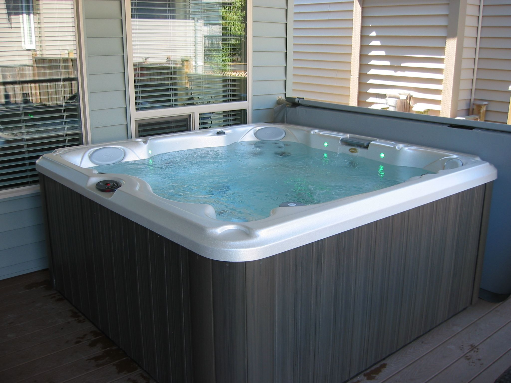 Indoor Or Outdoor Hot Tub With Cover That Pulls Back For