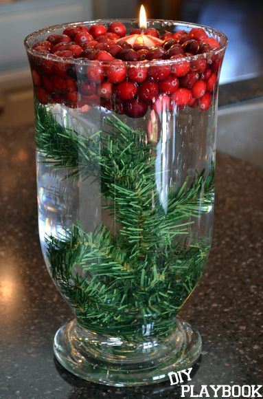 Cranberry Christmas Centerpiece. This is an easy DIY project. Take fresh cranberries, a floating candle, and some greenery and add it to a vase with water.