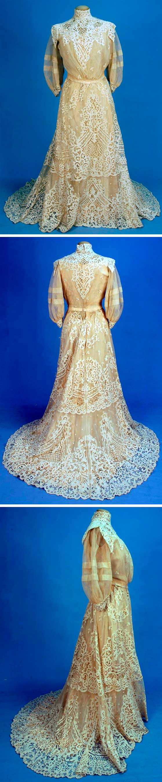 Lace gown, ca. 1904. Two-piece cream net with 3/4 balloon sleeves and floral applique lace with cloverleaf lattice over boned silk bodice. Chiffon underskirt with pleated hem ruffle. Silk lining. Whitaker Auctions