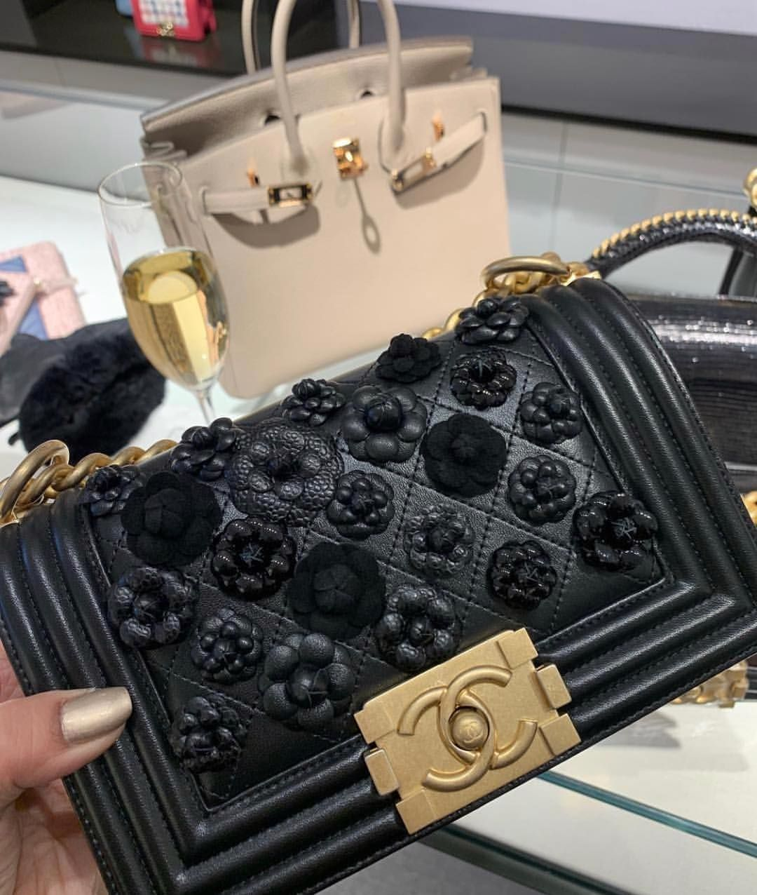 1aea0bcf84  chanel iconic  Boy  shoulder bag in black leather and floral details. At   6