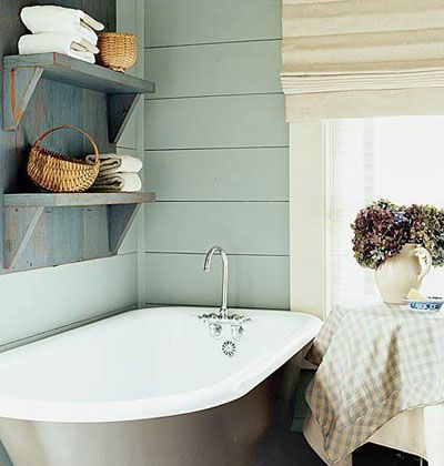A cool blue color scheme makes this small bathroom an instant place to relax. For added comfort, add stacks of fluffy towels                             and a pretty flower arrangement.