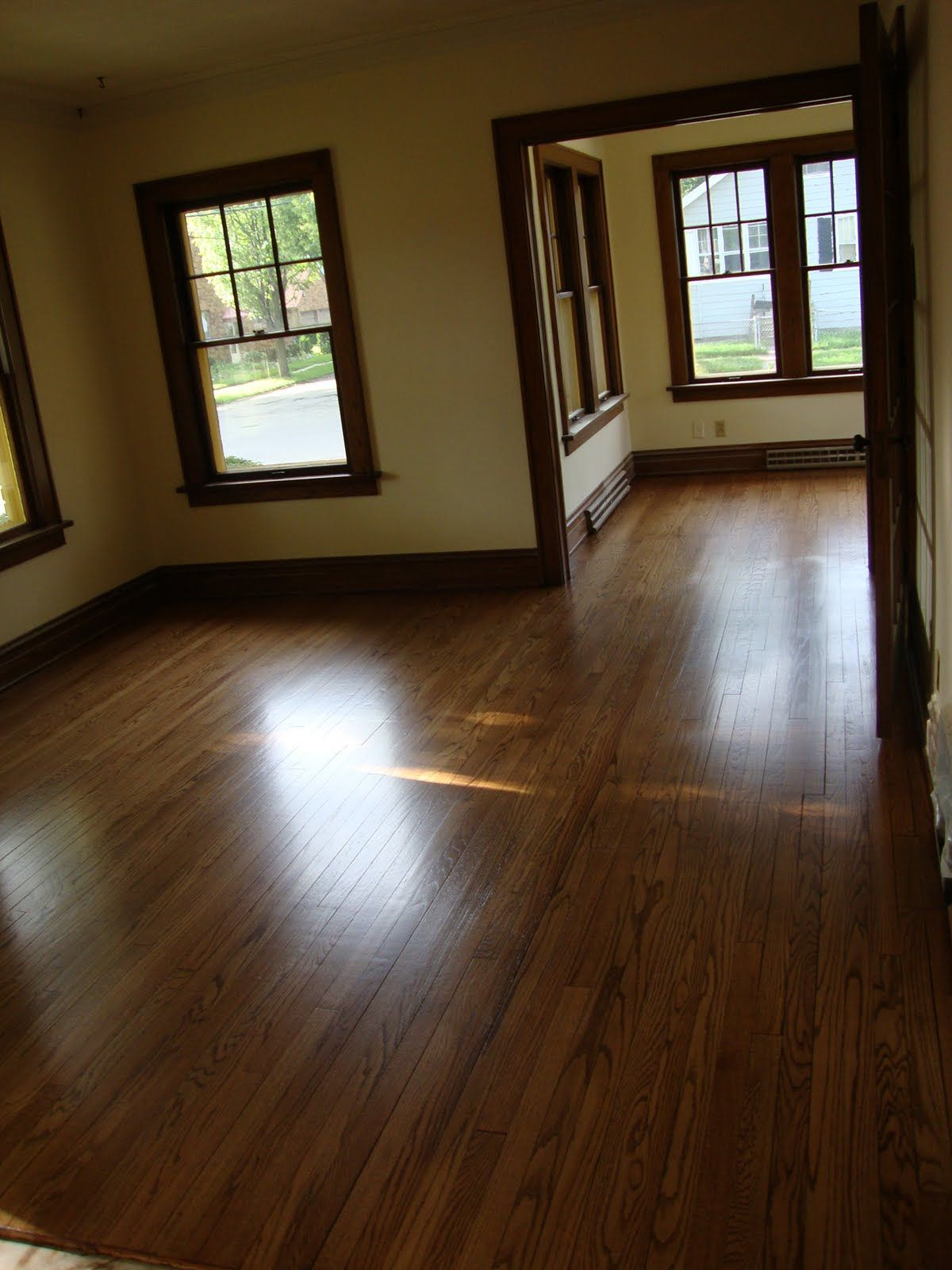 dark wood trim with hardwood floors and lighter, not-sterile white