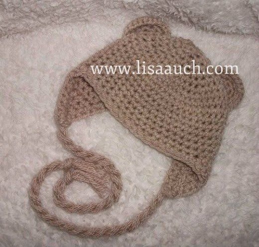 Make a baby animal hat with ears and earflaps to keep baby cosy ...