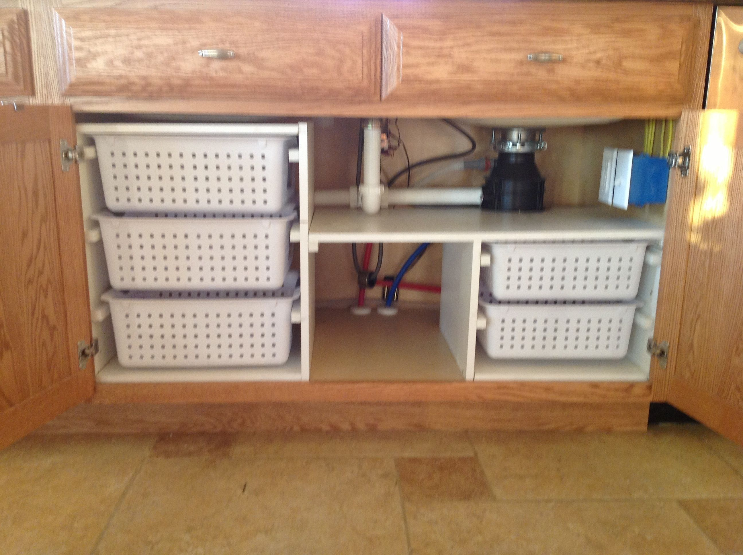 Under kitchen sink organization my husband built for Kitchen under cabinet storage ideas