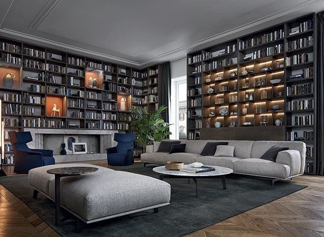 The wall system bookcase from poliform is a study in sophistication seen here perfectly framing this living space also featuring the tribeca sofa