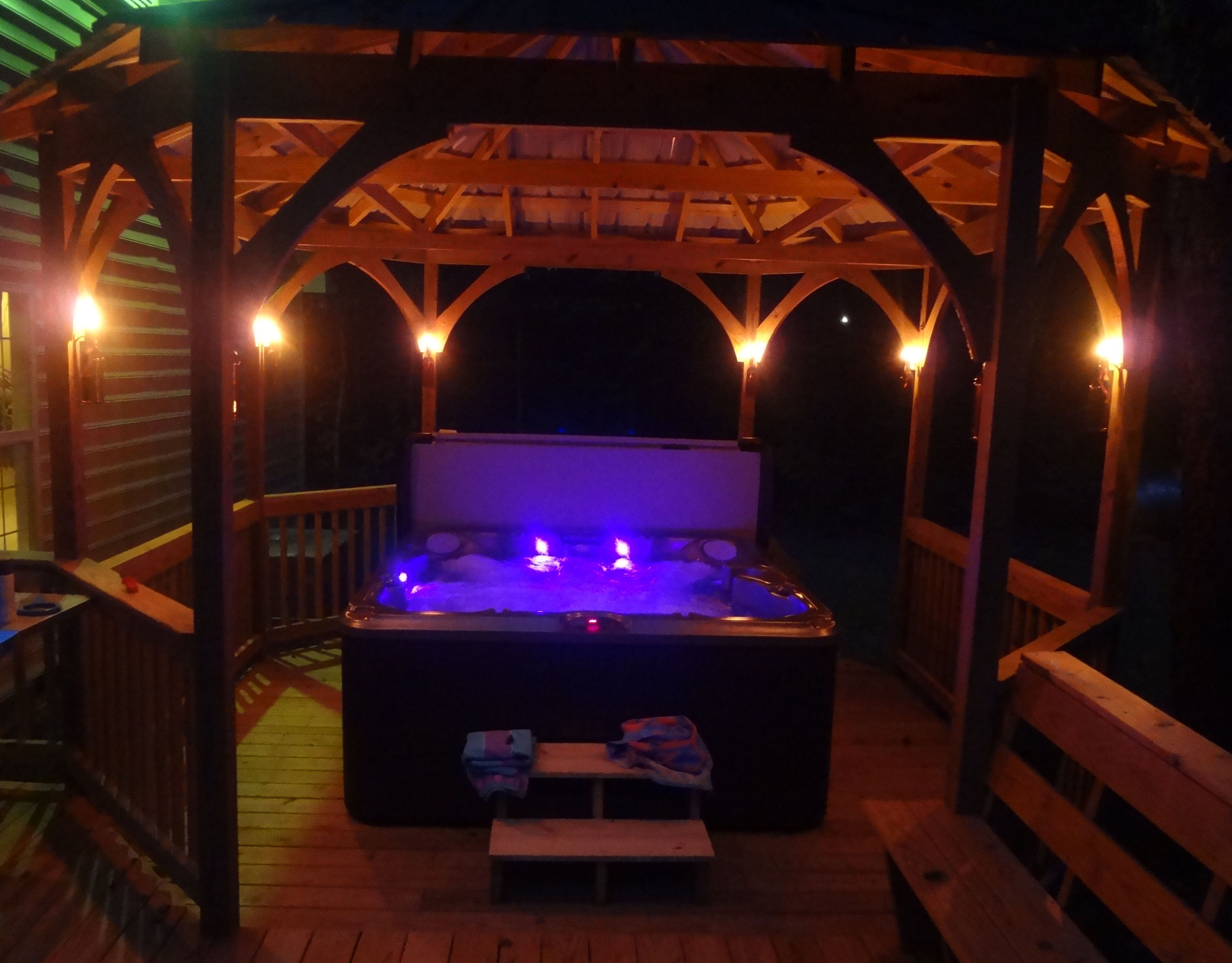 night view of our tub with the wine bottle tiki torches lit