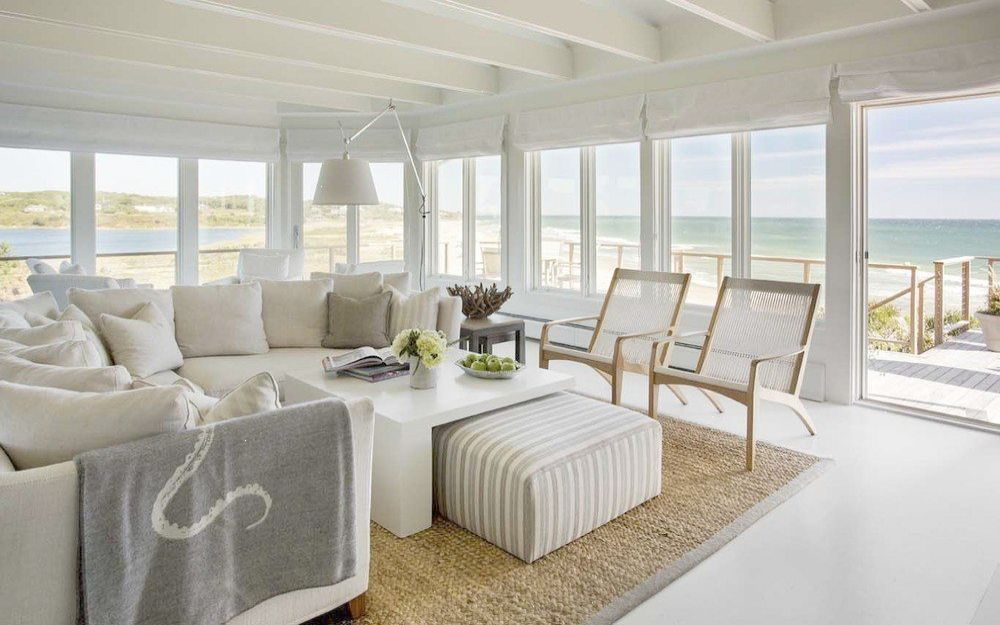 With Breathtaking Oceanfront Views At Every Turn This Stunning Beach House Designed By Martha S Beach House Living Room Beach House Interior Modern Beach House
