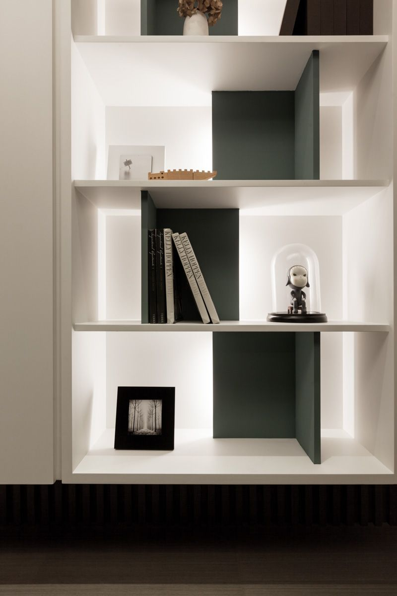 Shelves at entry edge of wall of storage black and white with