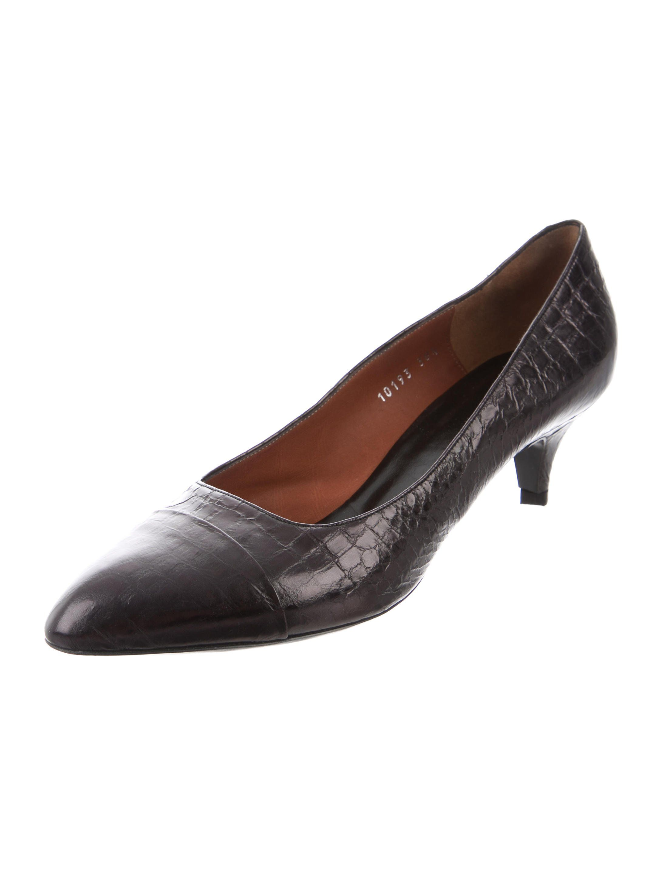 3a859b73bd Black embossed leather Dries Van Noten round-toe pumps with cap-toes and  covered heels.