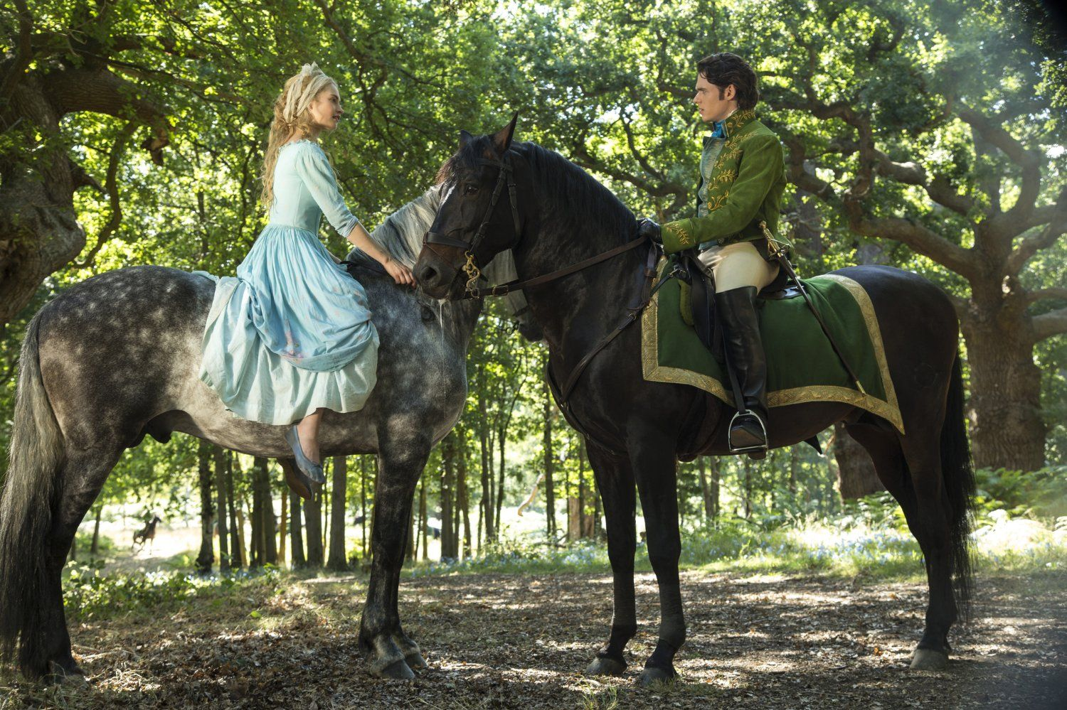 Richard Madden and Lily James in Cinderella (2015)