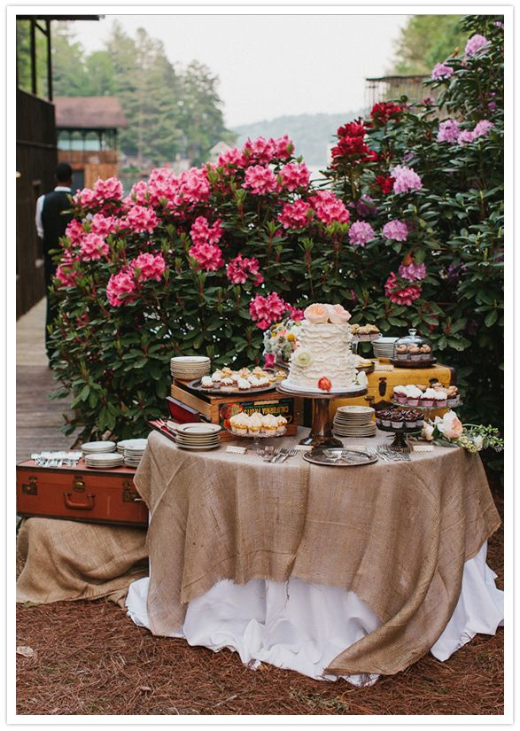 burlap-covered dessert table and vintage accessories