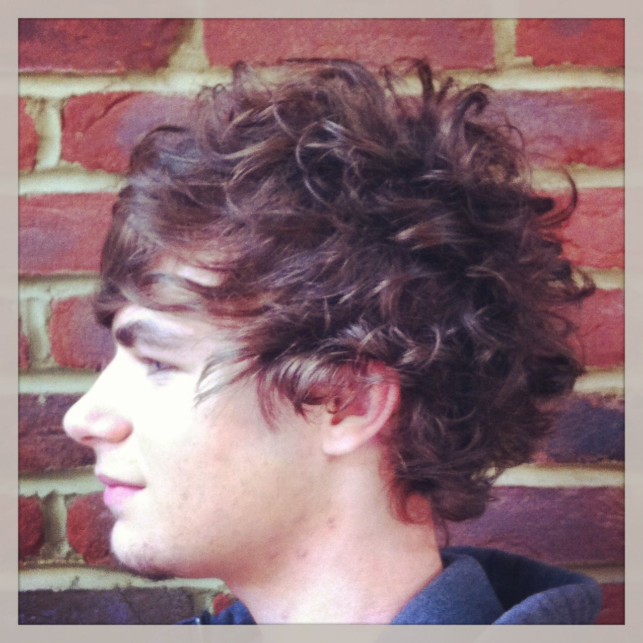 Gents haircut. Enhancing natural curls. Soft texture through out. Short internal layers for ...