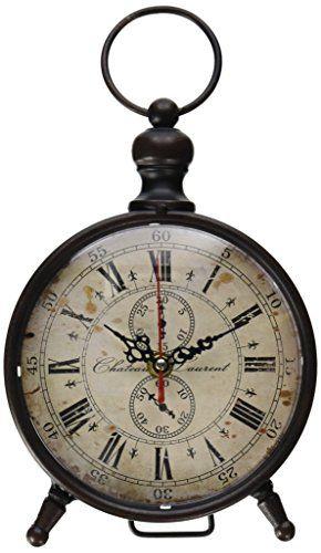 "Blossom Bucket 1366-70085 Round Metal Table Clock, 9-1/2""... https://www.amazon.com/dp/B00DHKD3UY/ref=cm_sw_r_pi_dp_DCyyxbFK7PADJ"