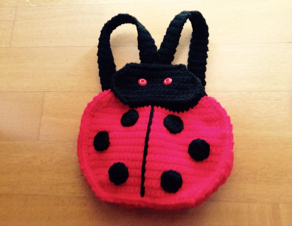 Lady bug backpack from a pattern by Patsy Harbor found in www.redheart.com
