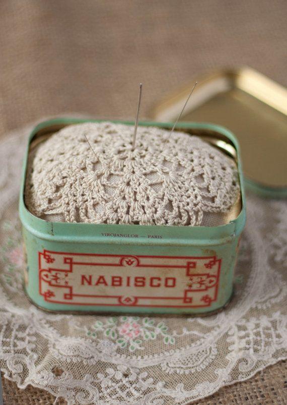 Vintage tin with doily pincushion