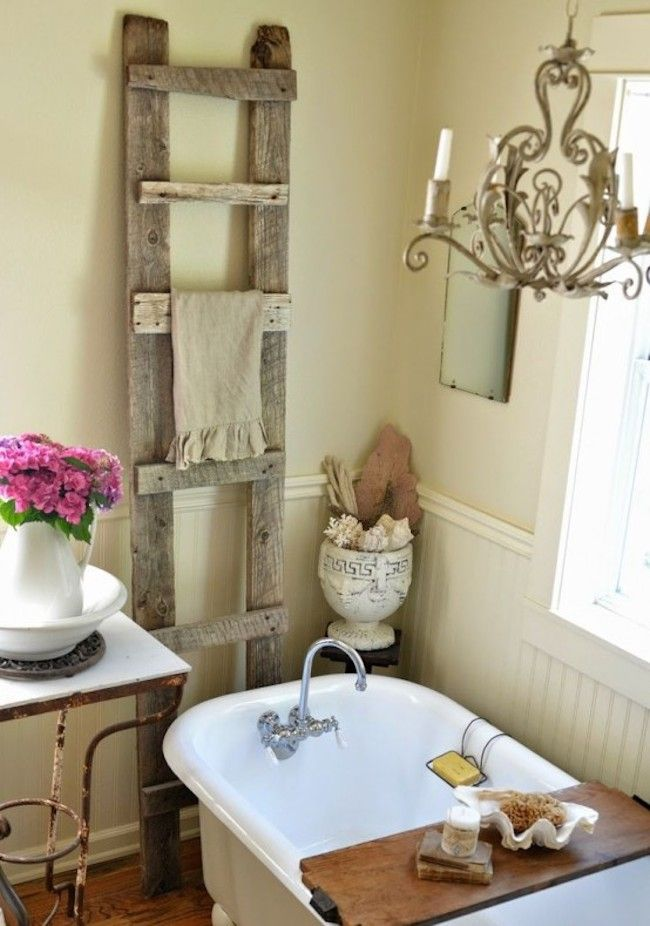 Wooden ladder adds a country feel to this shabby chic bathroom ...
