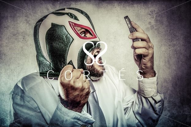 Office man arguing by phone, aggressive executive suit and tie, Mexican wrestler mask   Check more at http://fernandocortes.com/photostock/photography/office-man-arguing-by-phone-aggressive-executive-suit-and-tie-mexican-wrestler-mask-2/