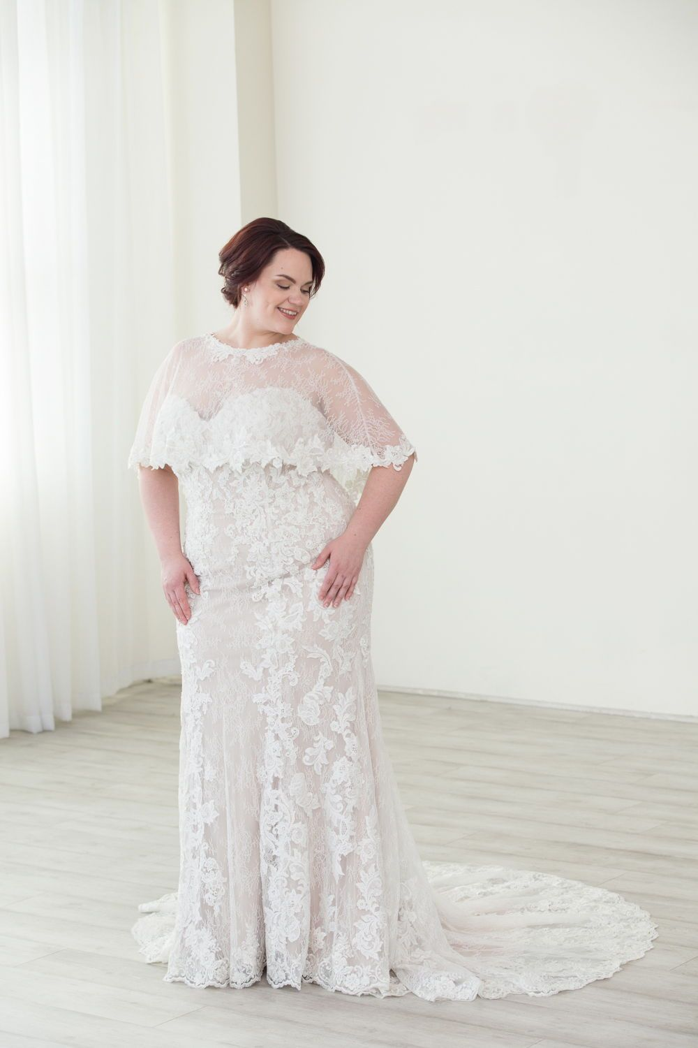 90ec1279dda29 Gorgeous fitted plus size wedding dress. Strapless lace wedding dress with  a capelet. Winter vibes in this plus size wedding gown from Justin  Alexander.