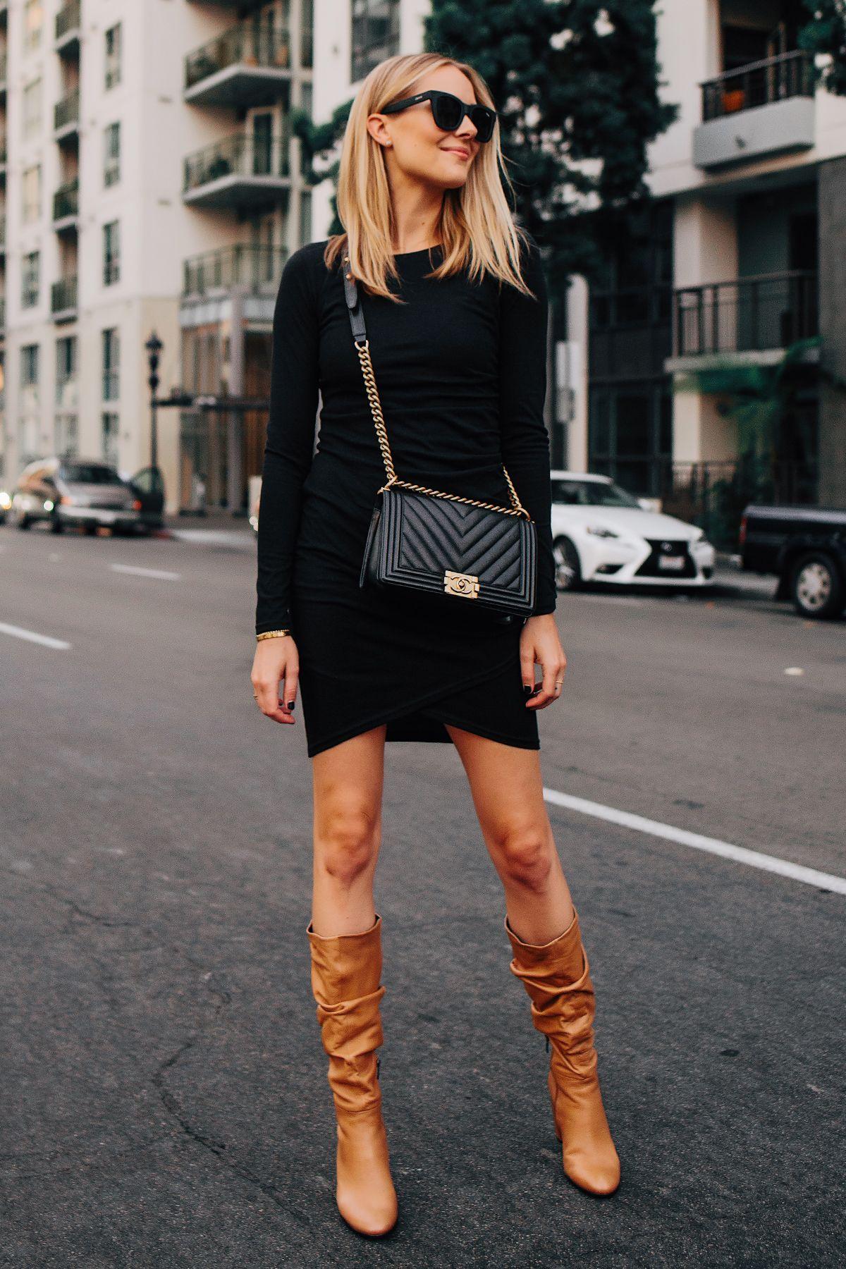 Blonde woman wearing black long sleeve bodycon dress ecco tan